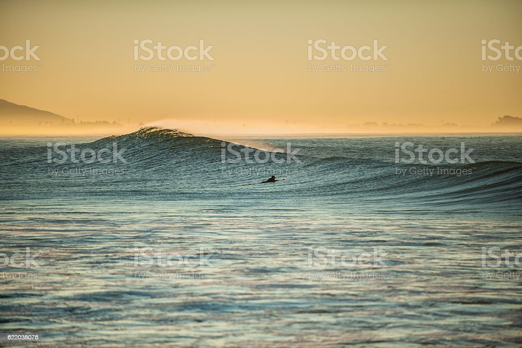 Timing the paddle out between sets. stock photo