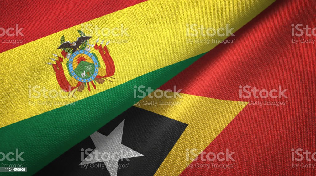 Timor-Leste East Timor and Bolivia two flags together textile cloth, fabric texture stock photo