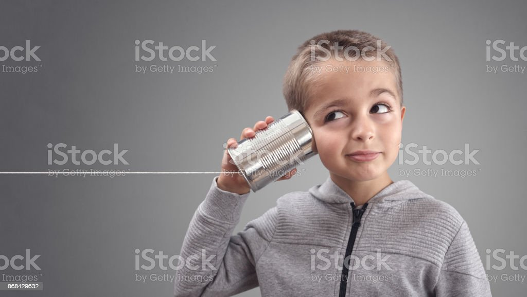 Tin can phone listening to curious good news stock photo