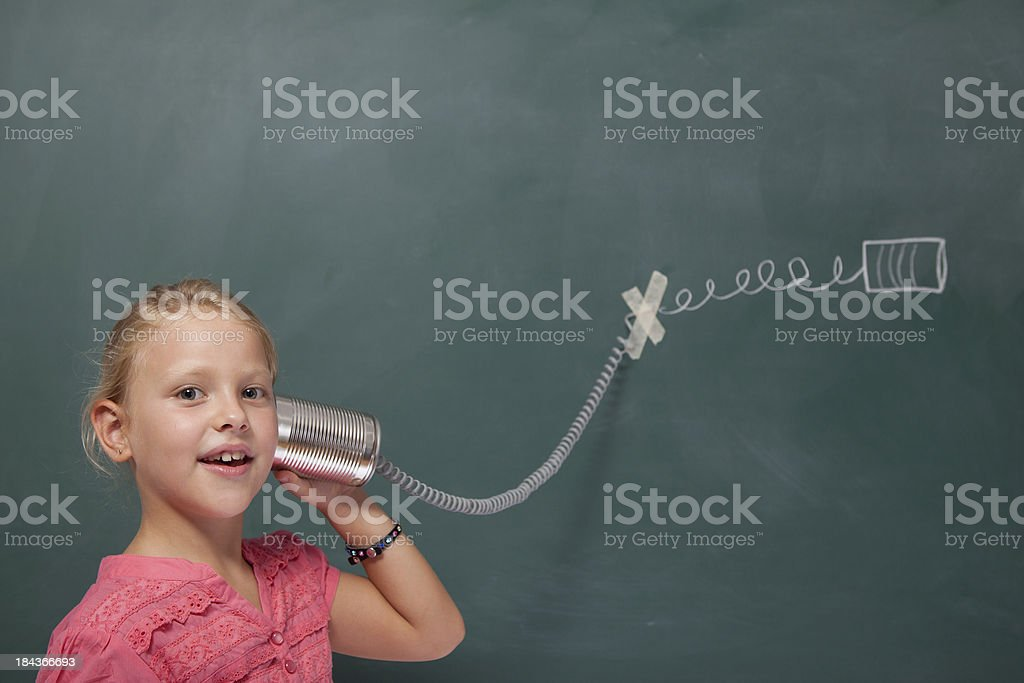 Tin can Phone on blackboard stock photo