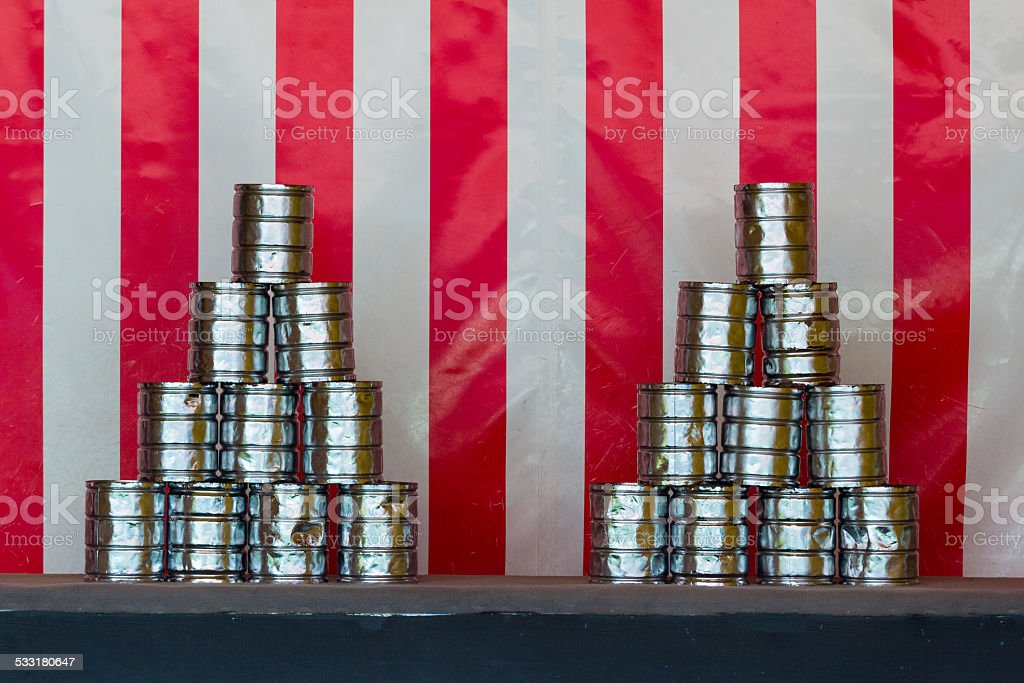 Tin can throwing stock photo