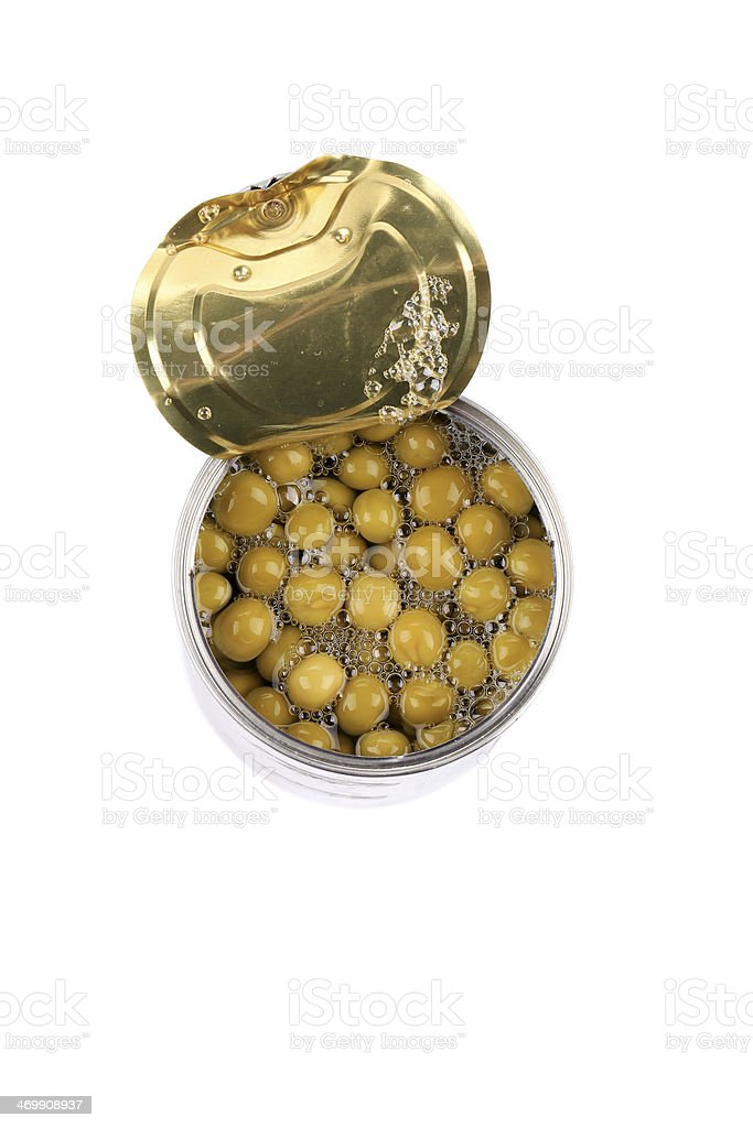 Tin can with green peas. royalty-free stock photo