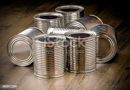 istock Tin cans for food on wooden background 492912294