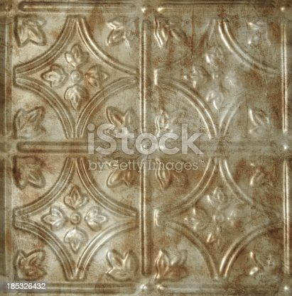 golden tin ceiling tile with decorative design