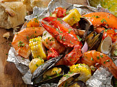 Tin Foil Wrapped Shellfish with Lobster, Tiger Prawns, Mussels, Clams and Vegetables