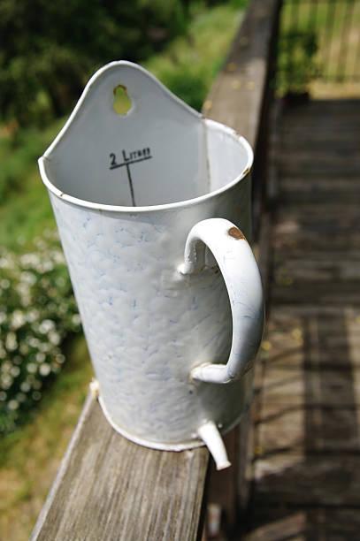 tin jar - rain gauge stock photos and pictures