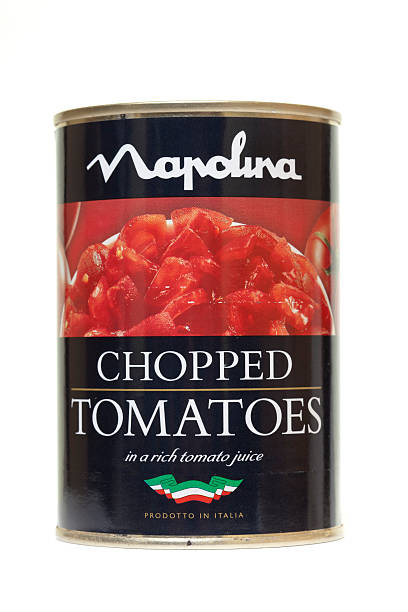 tin of napolina chopped tomatoes isolated on white - tomato can stock photos and pictures