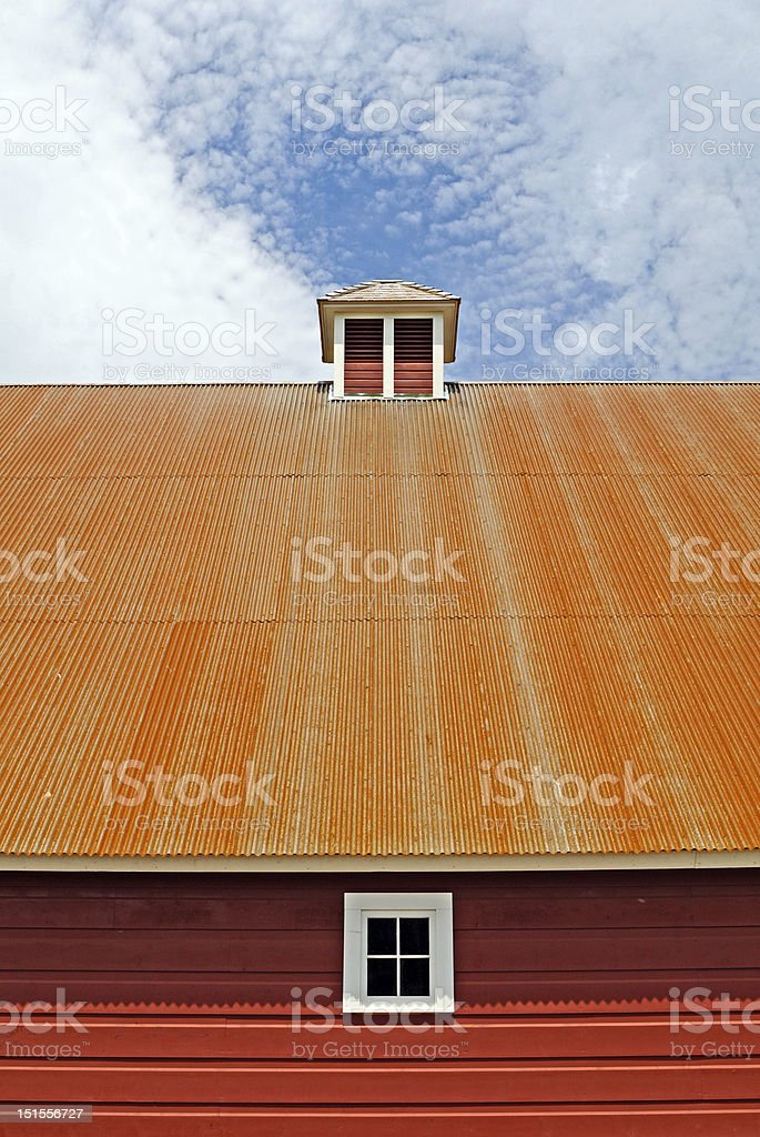 tin roof on red barn royalty-free stock photo