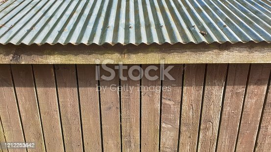 Corrugated tin roof and wooden planks