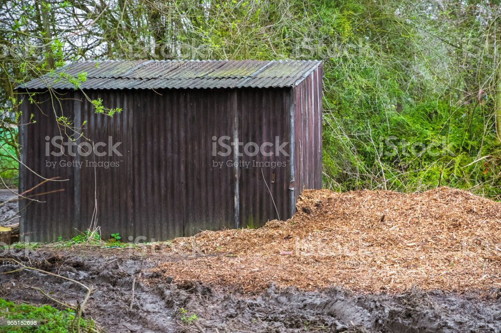 Tin Shack As Log Storage In English Countryside Royalty Free Stock Photo