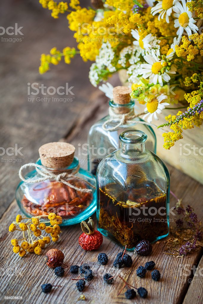 Tincture and healing herbs in box. stock photo