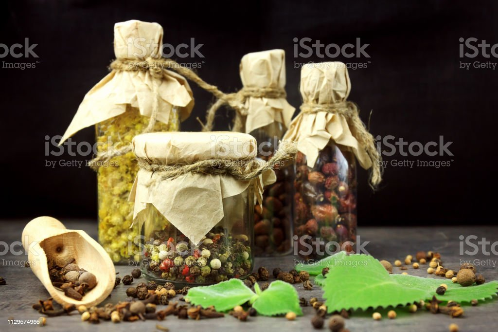 Tincture Bottles Assortment Of Dry Healthy Herbs Old Books