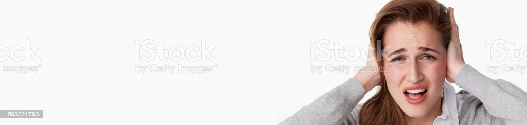 tinnitus concept for young woman having painful headache, copy space stock photo