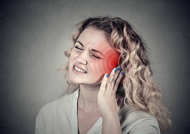 Tinnitus. Sick female having ear pain touching head – Foto