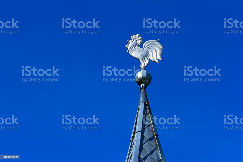 Tin-plate weathercock on the roof royalty-free stock photo