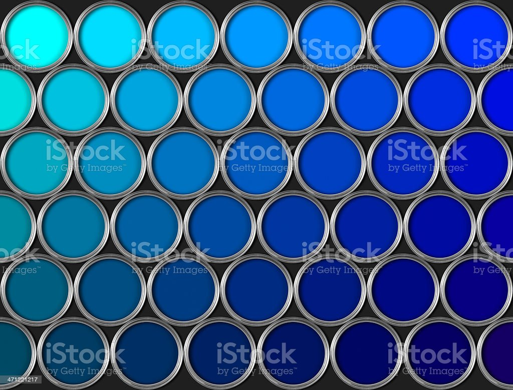 Tins of blue paint in rows on black background stock photo