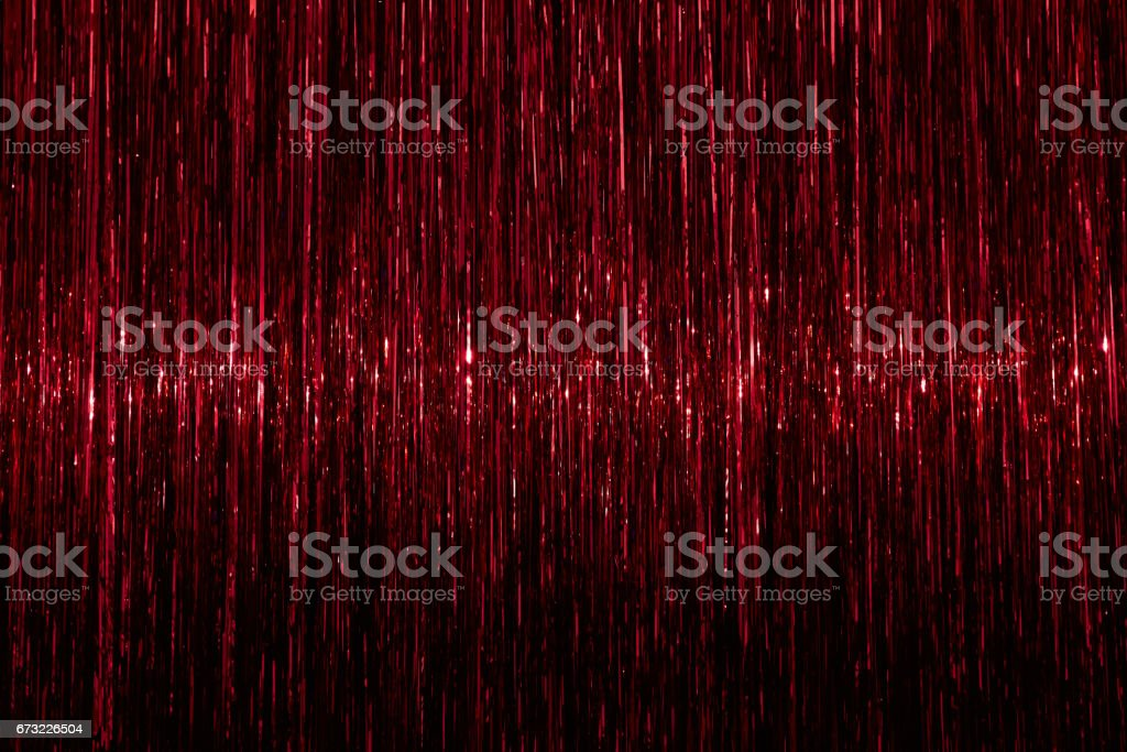 Tinsel background. Red sparkling abstract texture stock photo