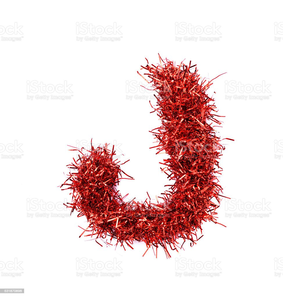 Tinsel Christmas decoration in form of letter J. stock photo