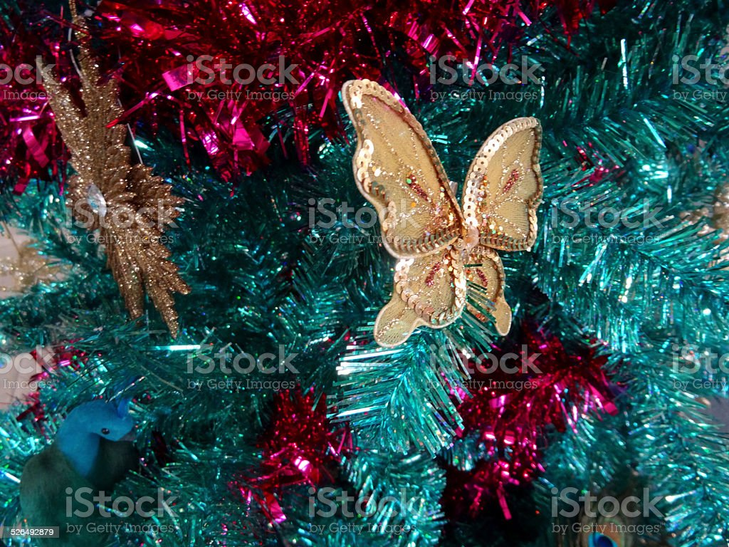 Tinsel Christmas Tree Green Turquoise Peacock Gold Snowflakes Butterfly Decorations Stock Photo Download Image Now Istock
