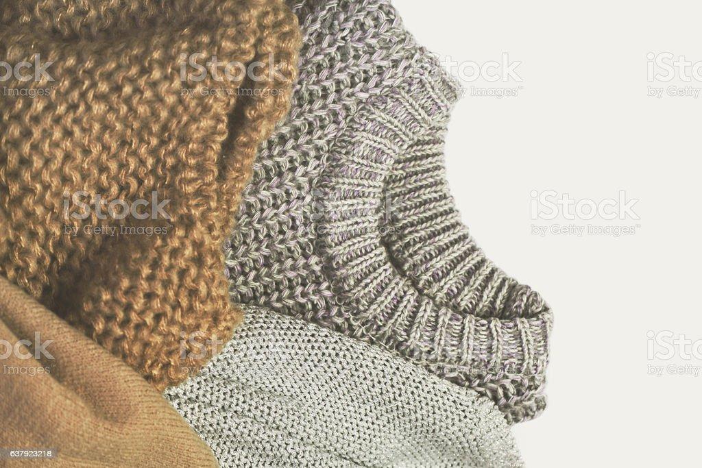 tinted image three warm sweaters on light background stock photo