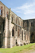 An old Tintern ruin site. This picture shows many columns and arches which would have been the most common way buildings were created. These buildings were able to withstand throughout time due to the way they were constructed. The materials used to build these buildings also play a role in their longevity.
