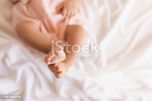 Tiny baby legs, hands and feet.
