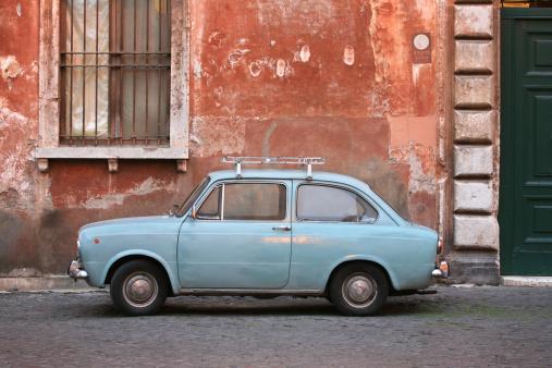 Tiny blue vintage car in Rome Italy
