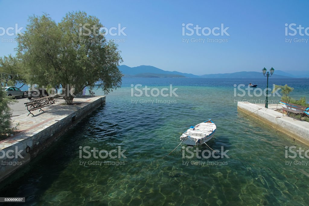 Tiny Boat on the Aegean Sea in Greece stock photo