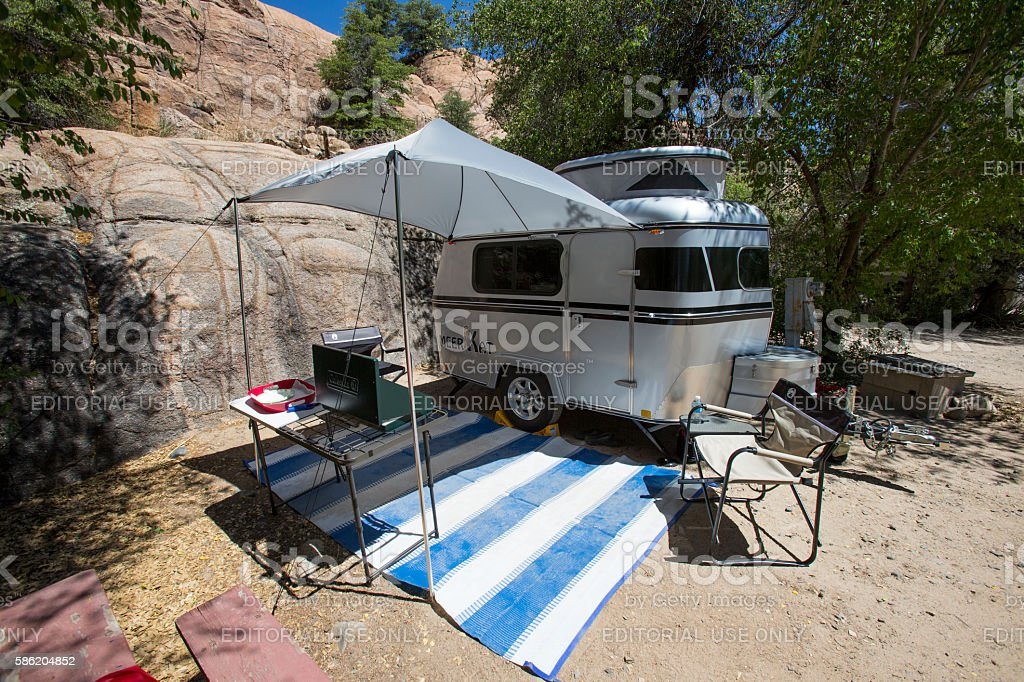 Tiny camper set up with awning stock photo