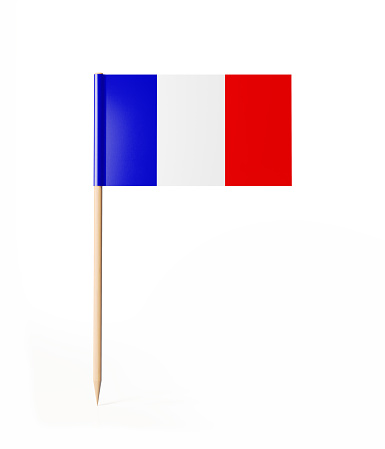 Tiny cocktail stick flag of France. With clipping path.