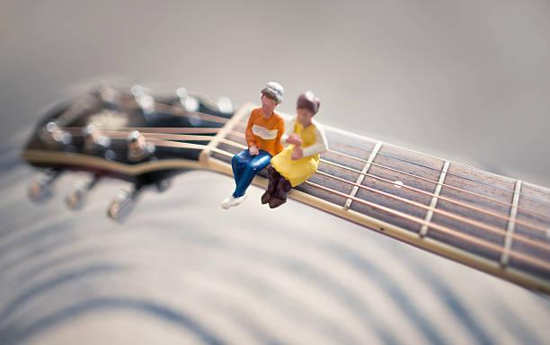 tiny couple listening live acoustics stock photo