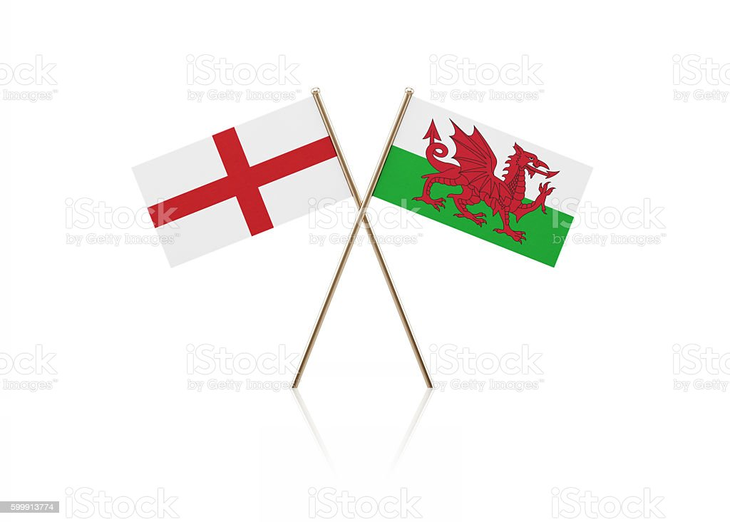 Tiny English and Welsh Flag Pair on Gold Sticks stock photo