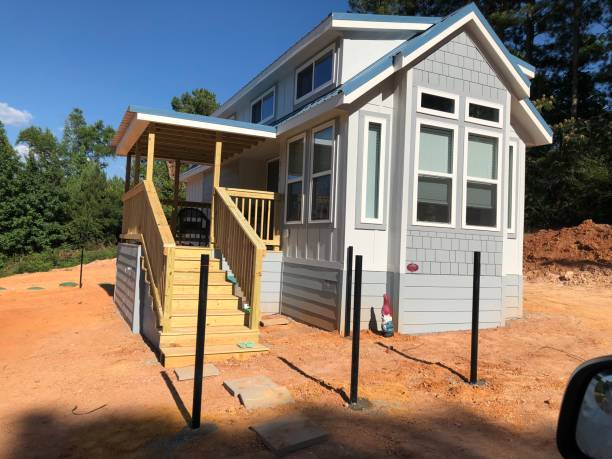 Tiny house In process Blue tiny house being built manufactured housing stock pictures, royalty-free photos & images