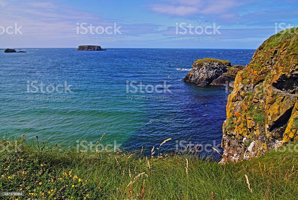 Tiny islands off the Irish Coast next to Carrick-a-rede island stock photo