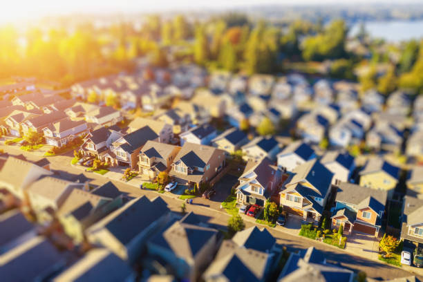tiny neighborhood aerial tilt-shift photo at sunset - residential district stock pictures, royalty-free photos & images
