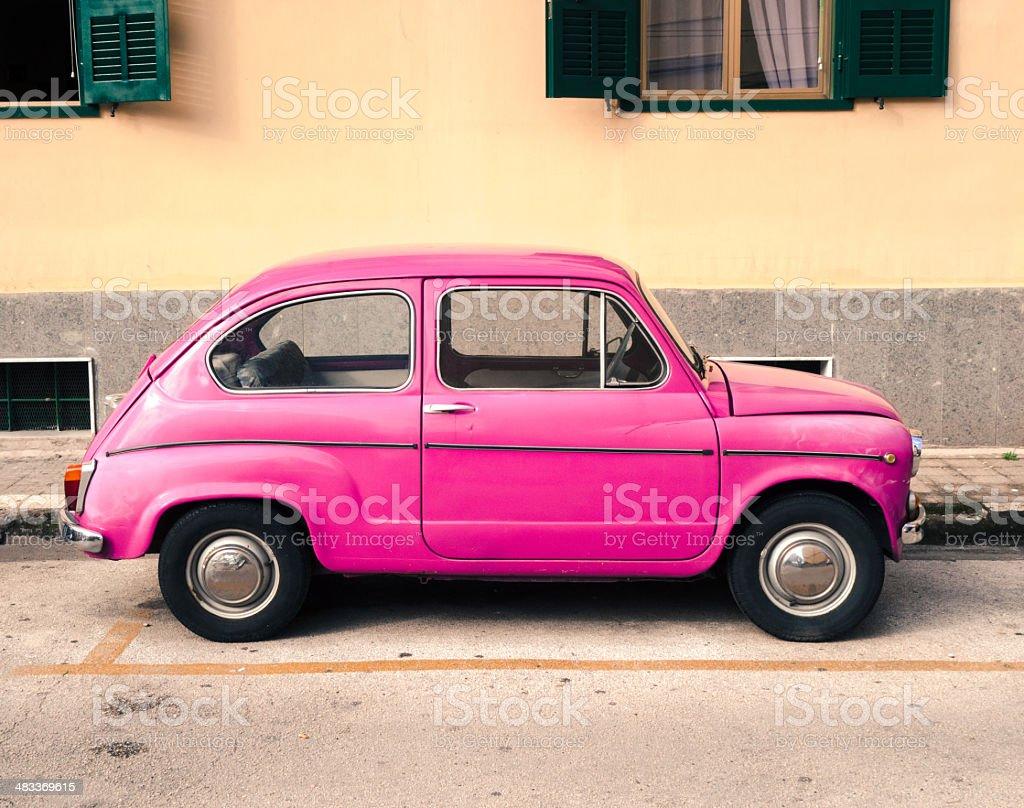 Tiny Pink Vintage Car, Italy stock photo