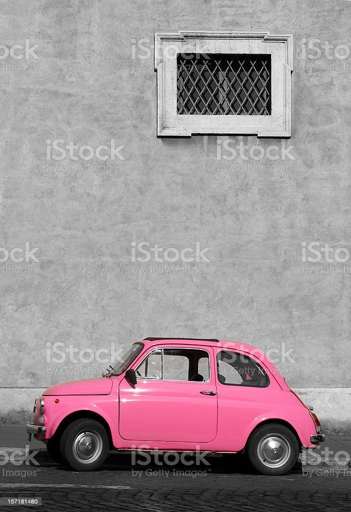 Tiny pink vintage car, Rome Italy stock photo