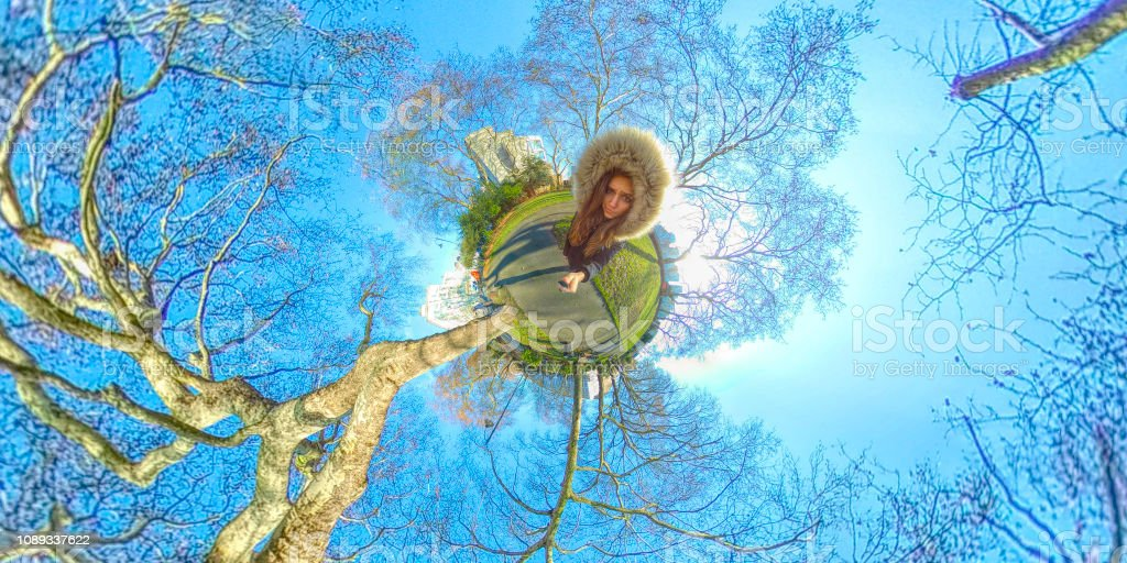 Tiny planet 360 view of beautiful Russian outdoor girl in London park stock photo