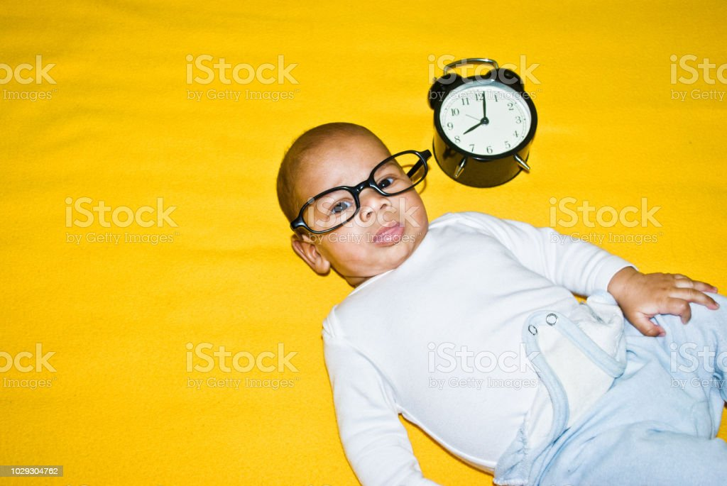 Tiny Rock Star Time Toddler In Large Reading Glasses On A Colourful