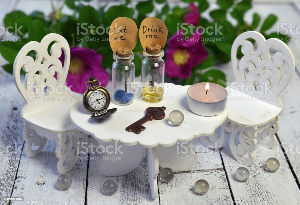 Tiny table with chairs and two bottles with tags stock photo