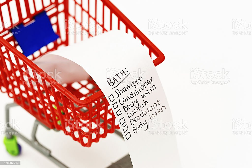 Tiny trolley with shopping list of bath essentials royalty-free stock photo