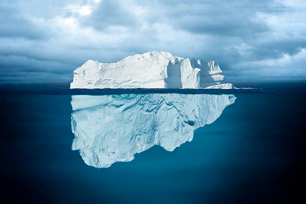 tip of an iceberg - iceberg stock photos and pictures