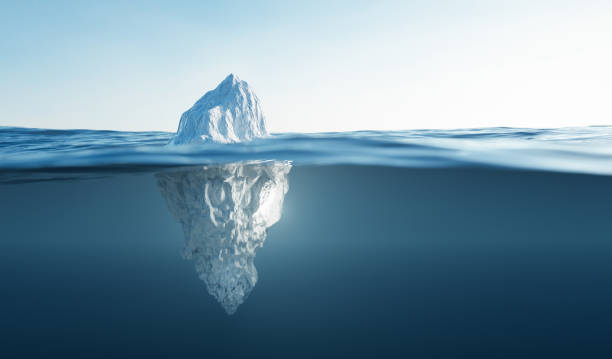 Tip of the iceberg. Half underwater. stock photo