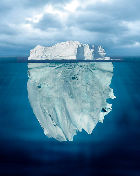 tip of the iceberg - iceberg stock photos and pictures
