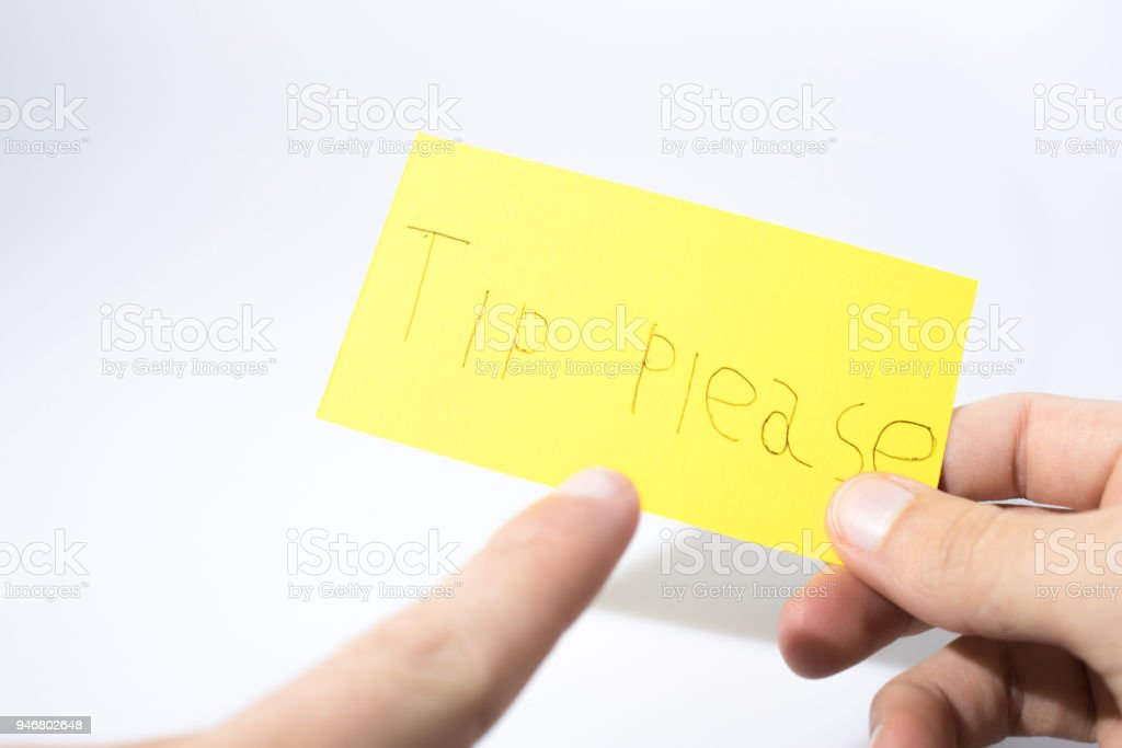 Tip please handwrite with a hand on a yellow paper composition stock photo