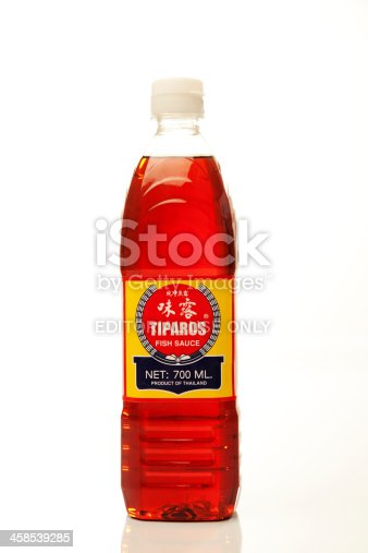 Colorado Springs, Colorado, USA - March 6th, 2011 A bottle of Tiparos Fish Sauce against white background. It is produced in Thailand.