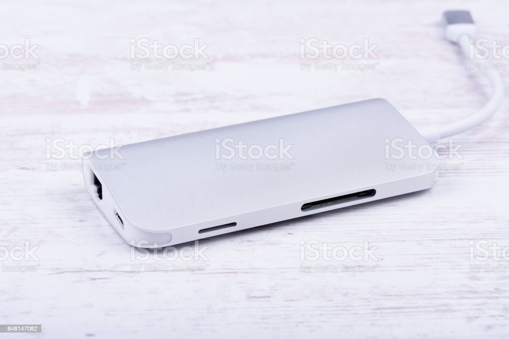 Tipe-C aluminum multiport adapter on white wooden background stock photo