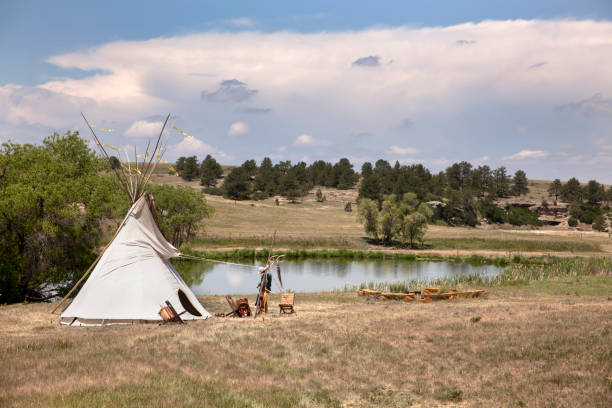 Near Franktown, Colorado on Open Space Day, a Native American tipi stands near a pond with meadows and canyons in the background, part of the 978 acres that make up of open space of Prairie Canyon Ranch in Douglas County.