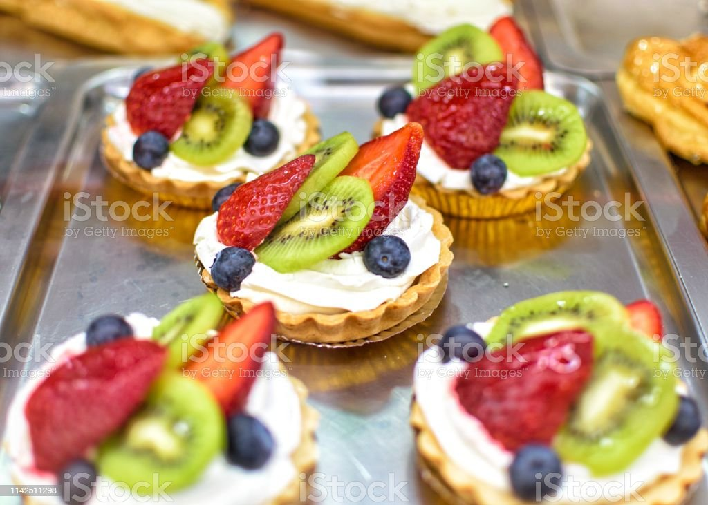 Tipical Spanish Pastry On A Display Case At A Coffee Shop Stock Photo - Download Image Now - iStock
