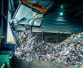 Tipping recycling into storage shed